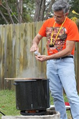Savannah Brewers League president Steve Matthews demonstrates homebrew