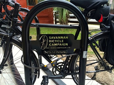 Secure bicycle parking has a role in reducing bike theft. This rack's at the Savannah Bicycle Campaign office on Lincoln Street.