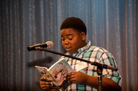 Shamil Ross of Derenne Middle School reads his work at the last Deep Speaks. Photo by Lief Carlson