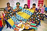 Some of the crafty denizens of Handmade Neighborhood art collective, left to right: Kara Richardson, Freda Jones, Tina Hicks, West Broad YMCA Loop it Up director Molly Lieberman, Phyllis Jones, Aalayah King and Barbara Morgan.