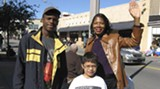 Spurgeon Goodrich and Charles and MarQuita McNeal at the parade