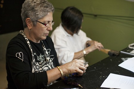 Tana Felicca-Flagg and Nancy Boyd work on their projects during an Open Studio Metals class, a self-directed class