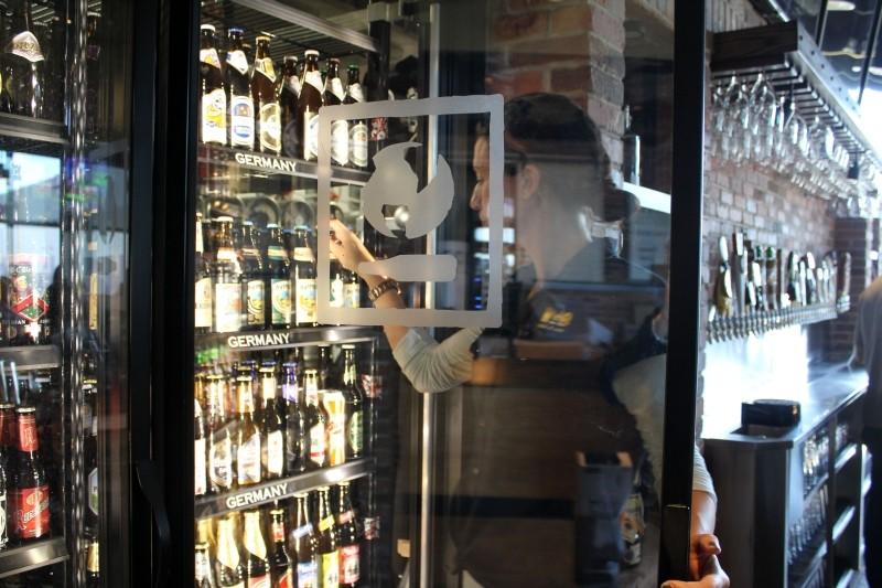 Tegan Foster stocks shelves at World of Beer Pooler
