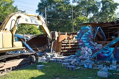 The bulldozer takes down the wall - JON WAITS/@JWAITS