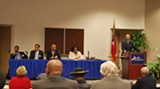 The candidates at last week's public forum; Mayor Johnson is at the podium