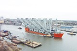 TERRY THOMPSON, CRESCENT TOWING - The Dockside Swift with its cargo of four Super Post Panamax cranes goes upriver to the GPA docks