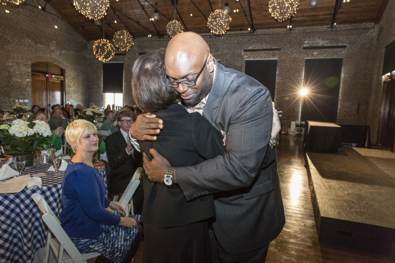 The Rev. C. MeGill Brown of Second African Baptist Church hugs Rosalie Morris. Mrs. Morris and her husband Charles are playing a key role in bringing the Canyon Ranch Institute's wellness program to an under-served population in Savannah.