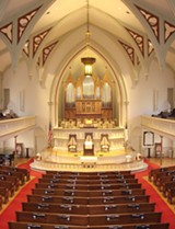 The sanctuary at Wesley Monumental featuring the historic organ