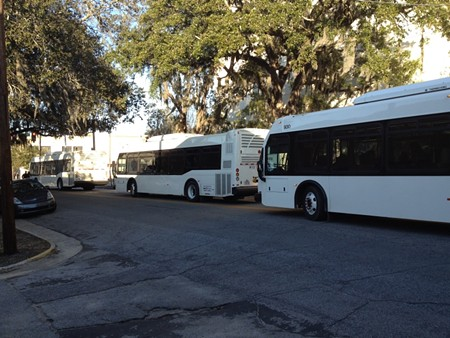 Three of the new SCAD buses backed up on Bull Street.