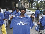 PATRICK RODGERS - Troy Davis's sister, Martina Correira, with the iconic T-shirt at the rally