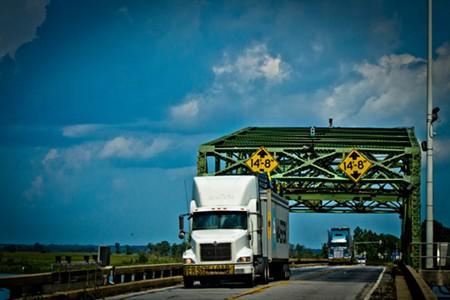 Trucks cross the historic Houlihan Bridge at Pt. Wentworth. - JON WAITS/@JWAITS