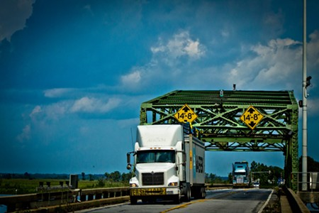 Trucks cross the historic Houlihan Bridge at Pt. Wentworth. - JON WAITS/@JWAITS