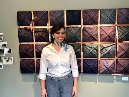 Caroline E. Hughes with her work.