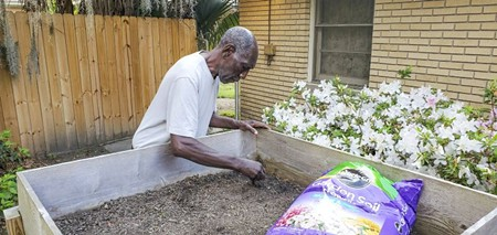 A local resident at one of United Cerebral Palsy's homes works on a gardening project.