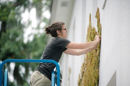 Artist Jamie Bourgeois designed the fern and fauna motif on the façade of Judge Realty to help commemorate 10 years in business and champion the cause of public art in Savannah. - DYLAN WILSON