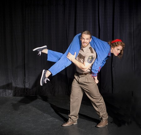 Flyboy Petruchio (Zach Burke) takes Kate (Deanna Greif) for a spin