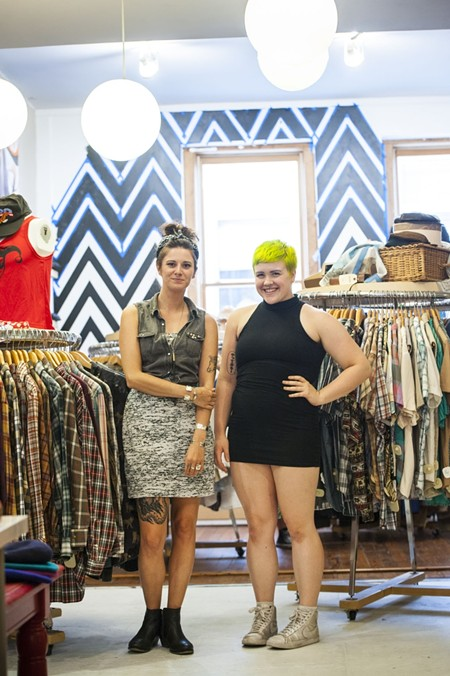 Everything old is new again: Staff members Emily Boutwell and Cassidy Hatcher report a smooth transition for Civvies's move to the former Primary Art Supply. - GEOFF L. JOHNSON