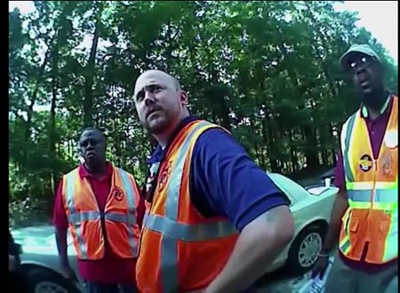 While legally attempting to inform truck drivers of their labor rights, union organizers (l. to r.)Jerome Irwin, Ben Speight and Kedrix Murray were issued questionable citations by an officer who caught the whole exchange on his bodycam.