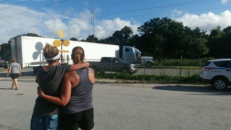 #SAVforLA co-conspirators Crystal Brooks and Courtney Rawlins watch the supplies head out.