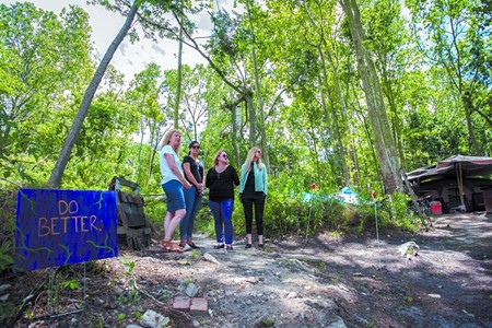 Below: Homeless Authority director Cindy Kelley surveys the site with fundraising partners Meredith Sutton, Sarah Shartzer and Lori Judge. - PHOTO BY JON WAITS