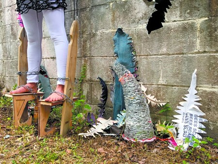 Leah Blair's stilts represent a year of NOAA expected sea level rise in Savannah, taking a statistic and making a visual representation.