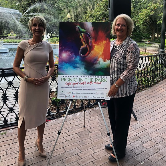Executive Director Terri O'Neil and theme contest winner Lucinda Shultz pose with the official Picnic in the Park poster.