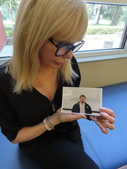 Lesli Messinger with a photo of her late son Austin