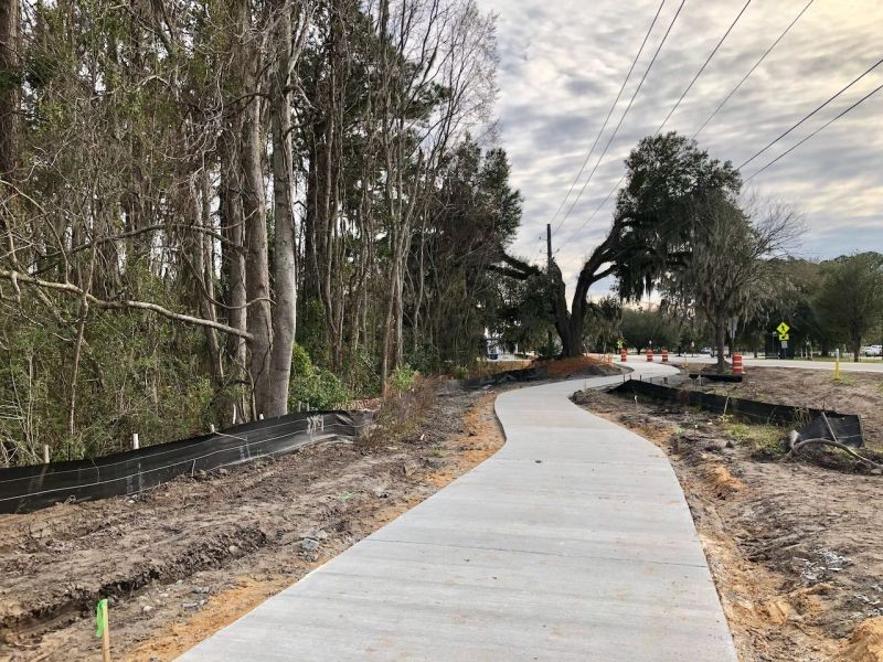 Concrete has been poured on the path of the Truman Linear Park Trail adjacent to Sally Mood Drive. Chatham County is constructing the segment of the trail that runs from Lake Mayer Community Park to DeRenne Avenue.