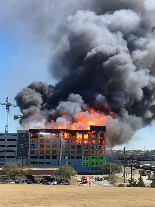 The view of the Eastern Wharf fire soon after it began, from Trustees Garden to the west.