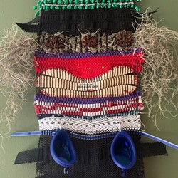 The totems incorporate unexpected items into the weaving.