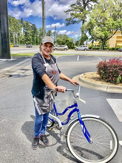 Frances, a bike recipient, received a bike, helmet and safety materials to help her get to her job.