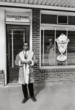 """James Baldwin, Colored Entrance Only, Durham, North Carolina"" by Steve Shapiro, 1963. Copyright of the artist and courtesy of Laney Contemporary, Savannah, and Jackson Fine Art, Atlanta."