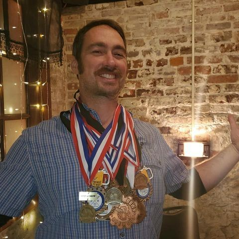 Jeremy Buddemeier with his 29 medals for competing in regional beer competitions (December 2019).