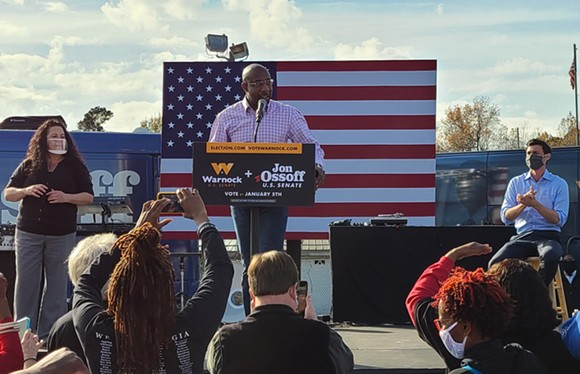 Georgia Democrat Raphael Warnock speaks at a rally to boost his U.S. Senate campaign, appearing along with Jon Ossoff and hip-hop artist Common, in Garden City on Dec. 19. - TAYLOR CLAYTON/CONNECT SAVANNAH