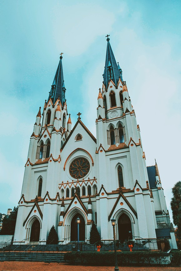 The exterior of Savannah's Cathedral Basilica of St. John the Baptist, decorated for Christmas. - ADRIANA IRIS BOATWRIGHT