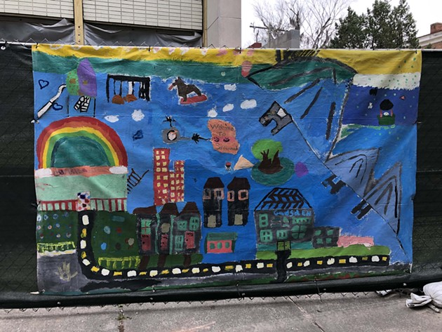 A Fence Art Project mural collaboratively painted by children in the Loop It Up Savannah program. - NICK ROBERTSON/CONNECT SAVANNAH