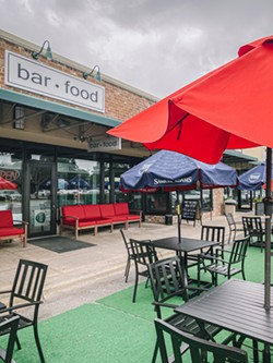 The outdoor seating area at Bar Food Sports. - LINDY MOODY