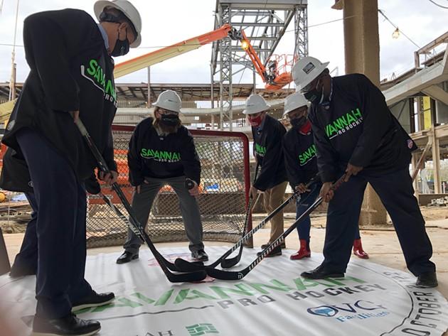 FROM RIGHT: Savannah Mayor Van Johnson, Alderwoman Linda Wilder-Bryan, and Alderman Nick Palumbo join in a ceremonial first hockey face-off at the Savannah Arena construction site on Jan. 27. - NICK ROBERTSON/CONNECT SAVANNAH