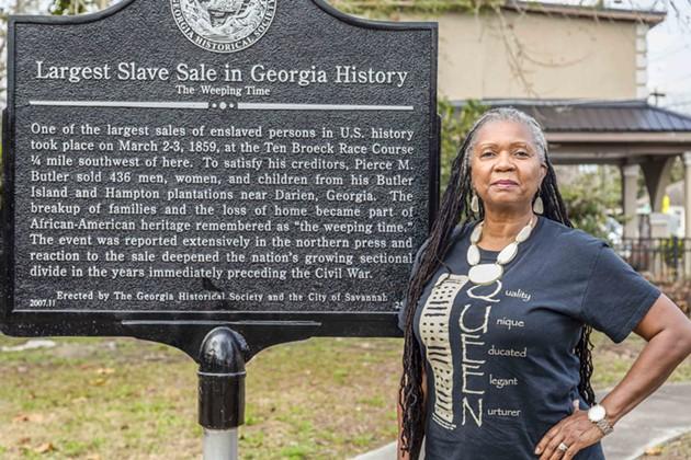 Savannah Alderwoman Bernetta Lanier stands by Savannah's historical plaque commemorating 'The Weeping Time.' - ALEX NEUMANN