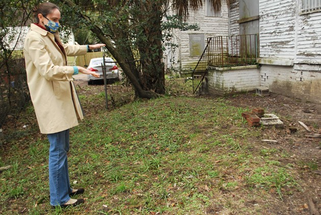 Laura Seifert, founder and director of Savannah Archaeological Alliance, points out restoration needed at the Kiah House Museum building. - NOELLE WIEHE/CONNECT SAVANNAH