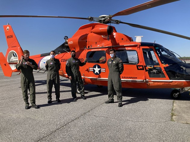 Members of the U.S. Coast Guard speak about aviation in the area March 19 during a media day on Hunter Army Airfield. - PHOTO BY NOELLE WIEHE