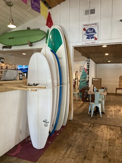 Boards sit on display March 23 inside Chamacos Tacos and Surf on Butler Ave. on Tybee Island.The shop is the only one on the island to offer locally-made surfboards, crafted by Jim Stephens. - PHOTO BY NOELLE WIEHE