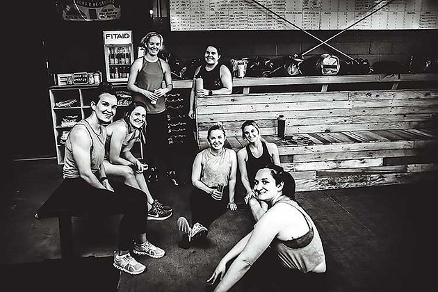 Members of River Drive Crossfit relax after finishing a workout in the facility in Thunderbolt. - PHOTO COURTESY OF RIVER DRIVE CROSSFIT