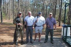 Curt Oelschig, Dee Pinckney,  Sales Pinckney and Larry Austin prepare to shoot clays. - PHOTO COURTESY OF ST. JOSEPH'S/CANDLER FOUNDATION