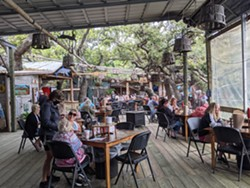 Customers enjoy the outdoor seating at the Crab Shack on Tybee Island. - PHOTO BY MELISSA HAYES