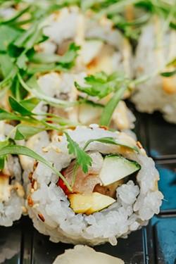 A patron orders the Yellowtail Kick at Riverside Sushi. - PHOTO BY LINDY MOODY