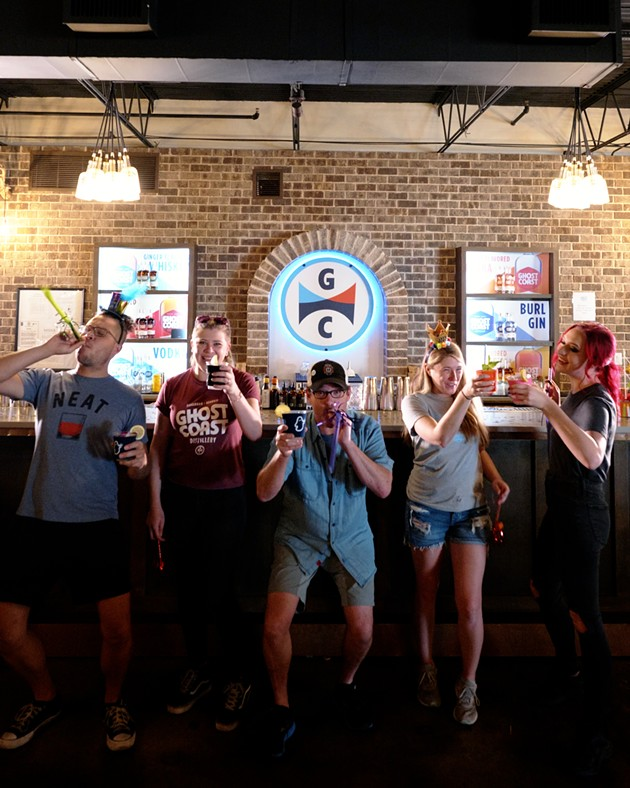 DJ Brown, Cory Reuter, Chris Sywassink, Sara Fullerton and Olivia Mayday, cheers their drinks and make noise as they are finally able to celebrate the distillery's fourth birthday. - PHOTO COURTESY OF DEVIN OLSON MEDIA