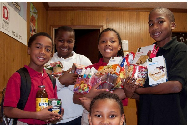 School children are grateful for Blessings in a Bookbag contributions. - PHOTO COURTESY OF BLESSINGS IN A BOOKBAG