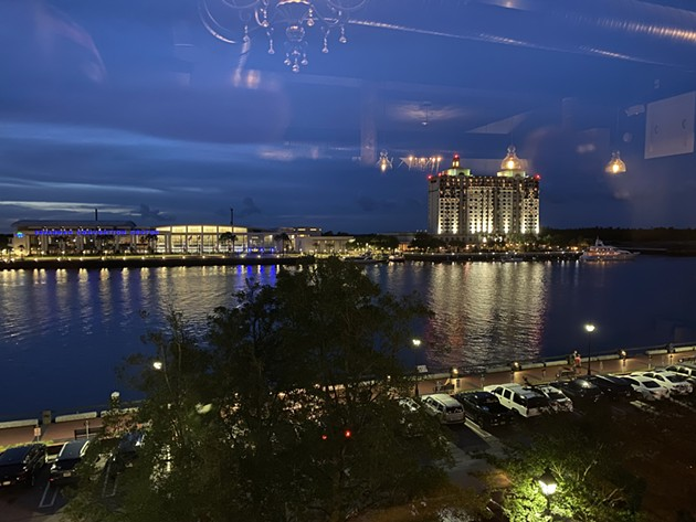 Jesse Blanco shows readers the view from a seat in the 208 Wine Bar on 208 E. Bay St. The wine bar has four large windows overlooking the Savannah River.  - PHOTO BY JESSE BLANCO