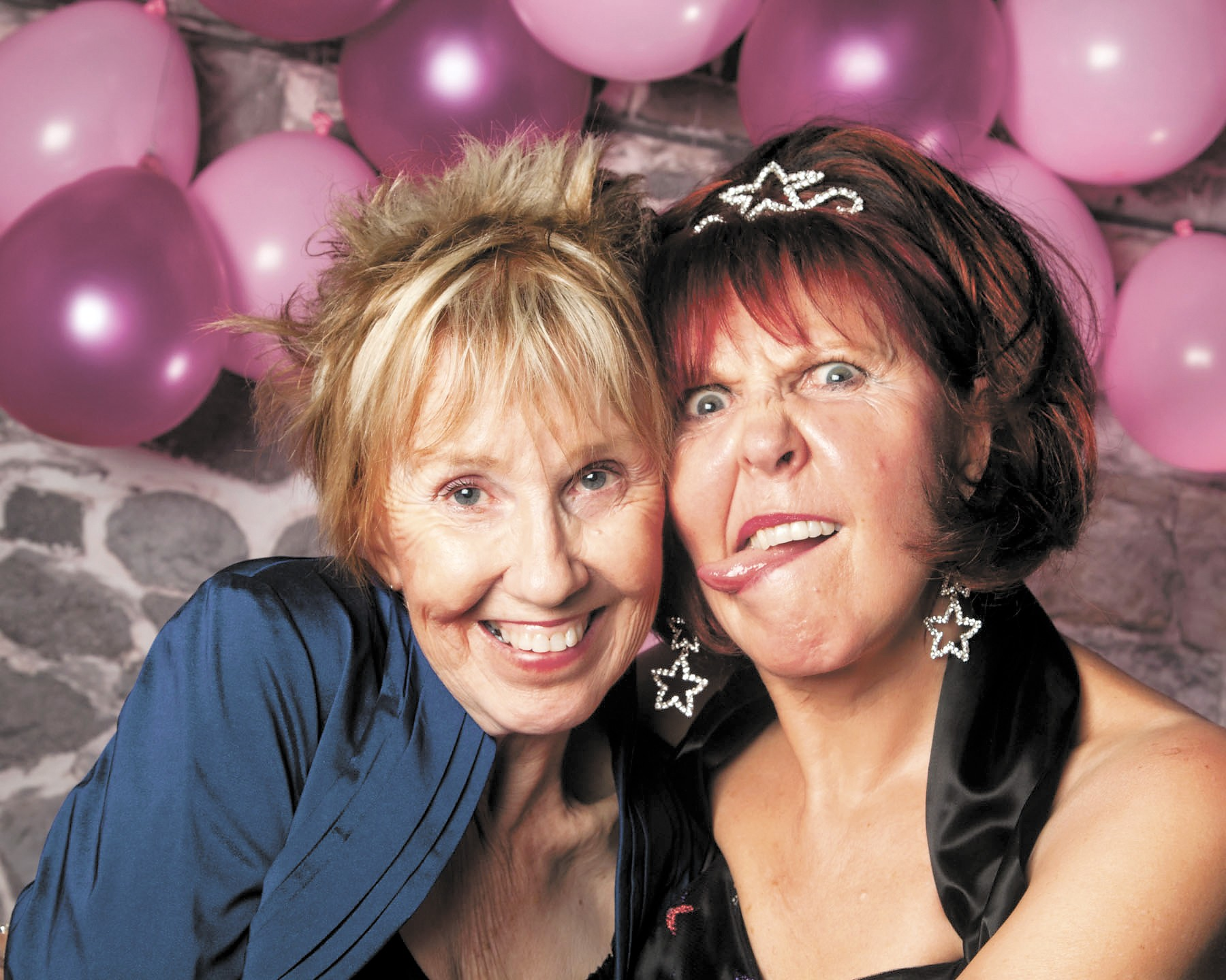 Sisters Shirley Sessions (l.) and Sandy McCloud reign as the Tybee Prom's spunky organizers. - WENMCNALLY.COM